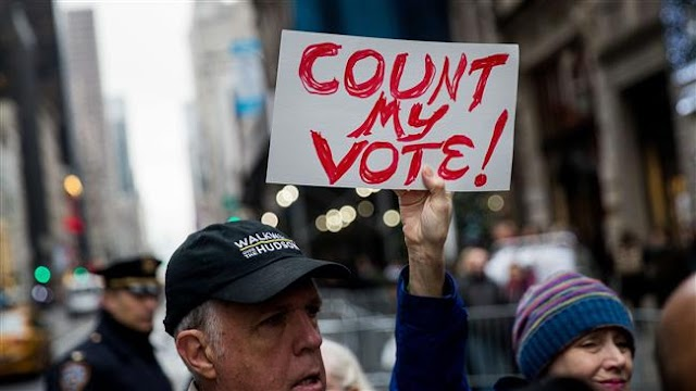 Wisconsin federal judge rejects bid to stop election recount