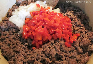 Mix ground beef with thawed onions & red peppers.