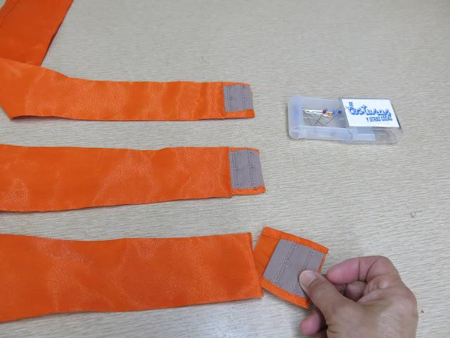 como coser corchetes de corsetería