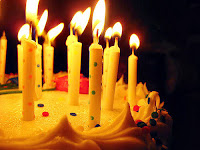 photo of candles on a birthday cake