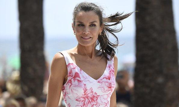 Queen Letizia wore Adolfo Dominguez floral print dress. Macarena espadrille wedges. Levante beach in Benidorm