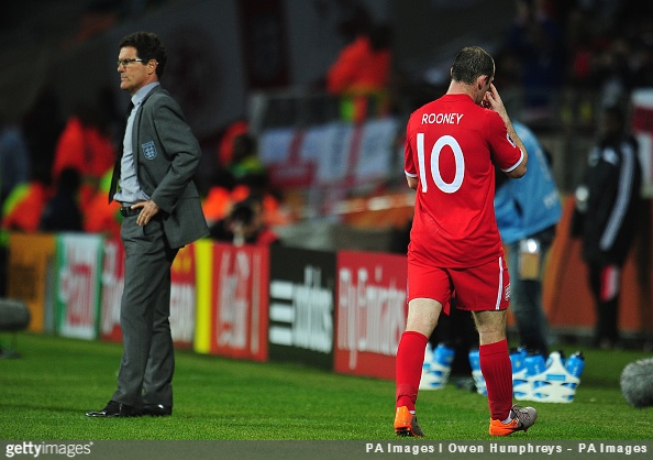 Wayne Rooney walks off the pitch after being substituted by manager Fabio Capello