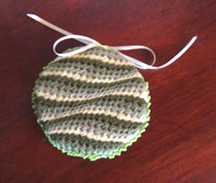 embroidered canvas work round needle book in greens and cream