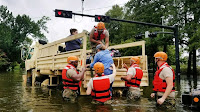 Texas National Guardsmen helping residents hit by flooding from Hurricane Harvey (Picture Credit: Army National Guard/Lt Zachary West) Click to Enlarge.