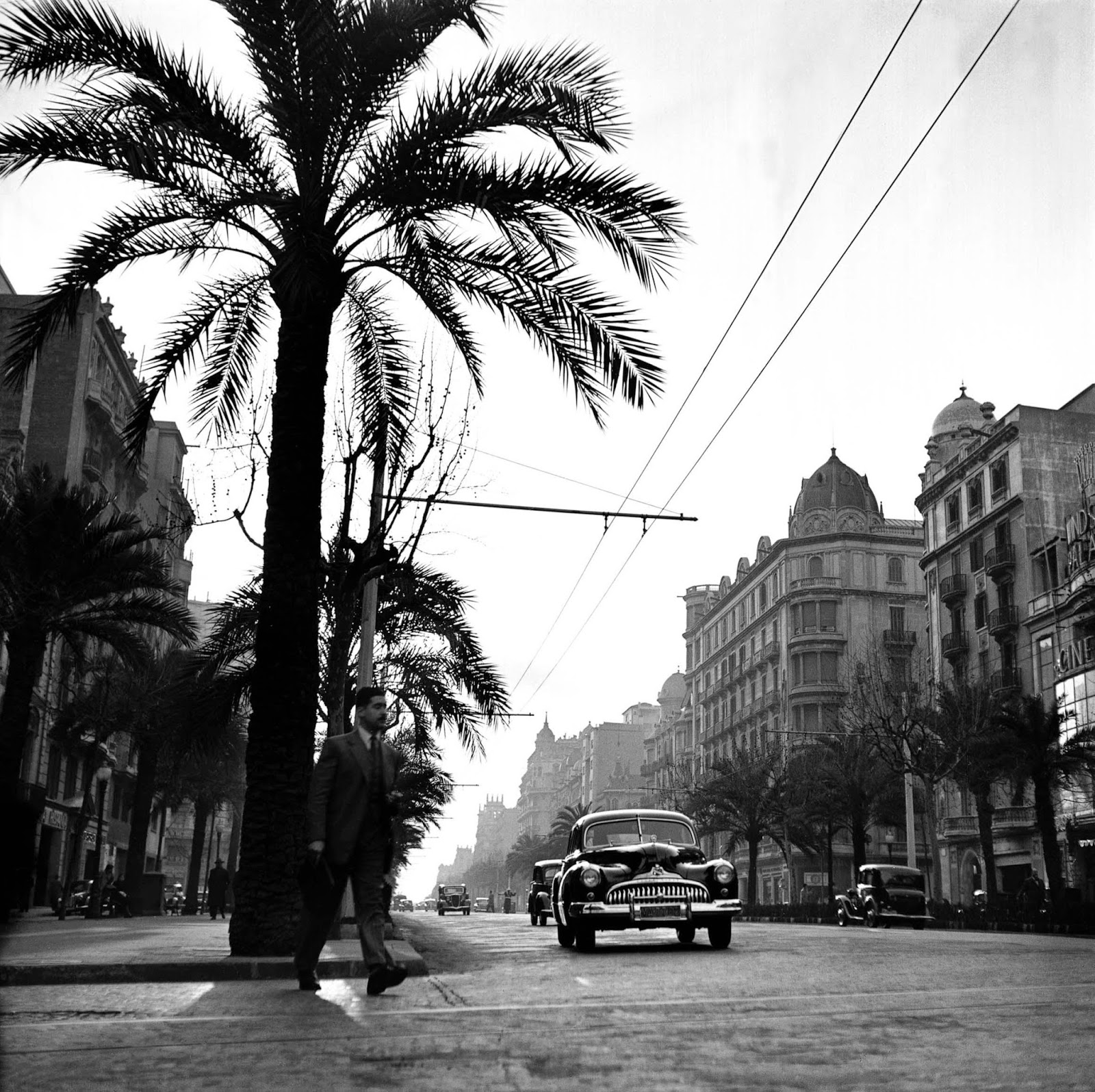 Below is a collection of amazing black and white photographs of madrid and barcelona of the 1950s taken by francesc català roca showing the street scenes