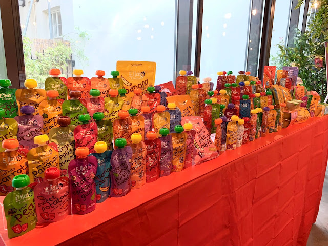 A display showing all the Ella's Kitchen products including lots of different pouches, snacks and other food in colourful packaging