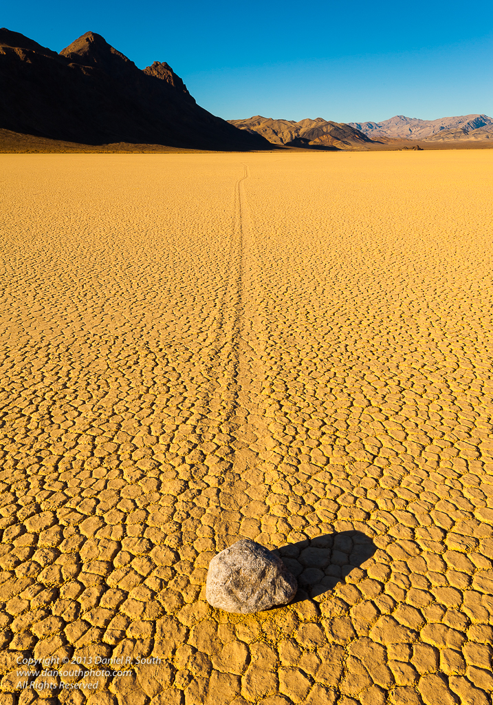 a photo of a sliding rock on the racetrack playa at death valley by daniel south