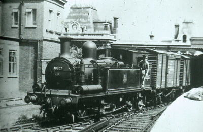 30207 arriving a Portsmouth High Level from Dockyard Line 1955