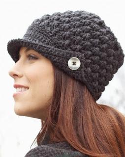http://www.yarnspirations.com/pattern/crochet/womens-peaked-cap