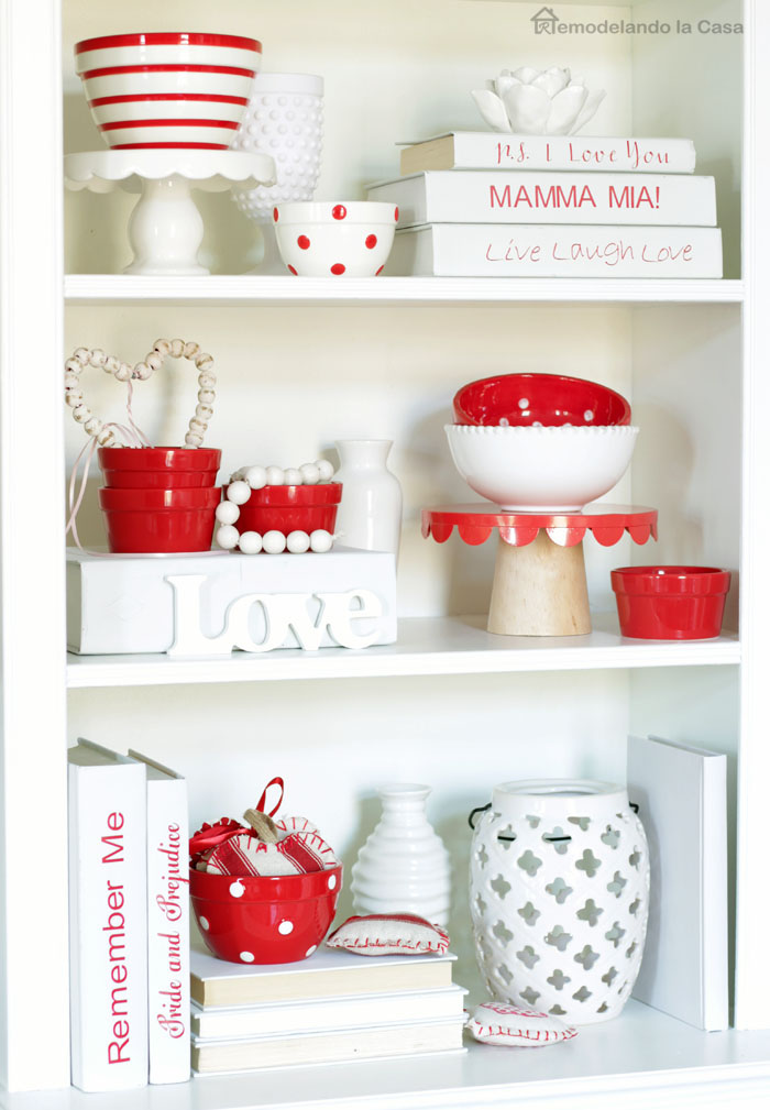 white and red cups, lantern, vases and books