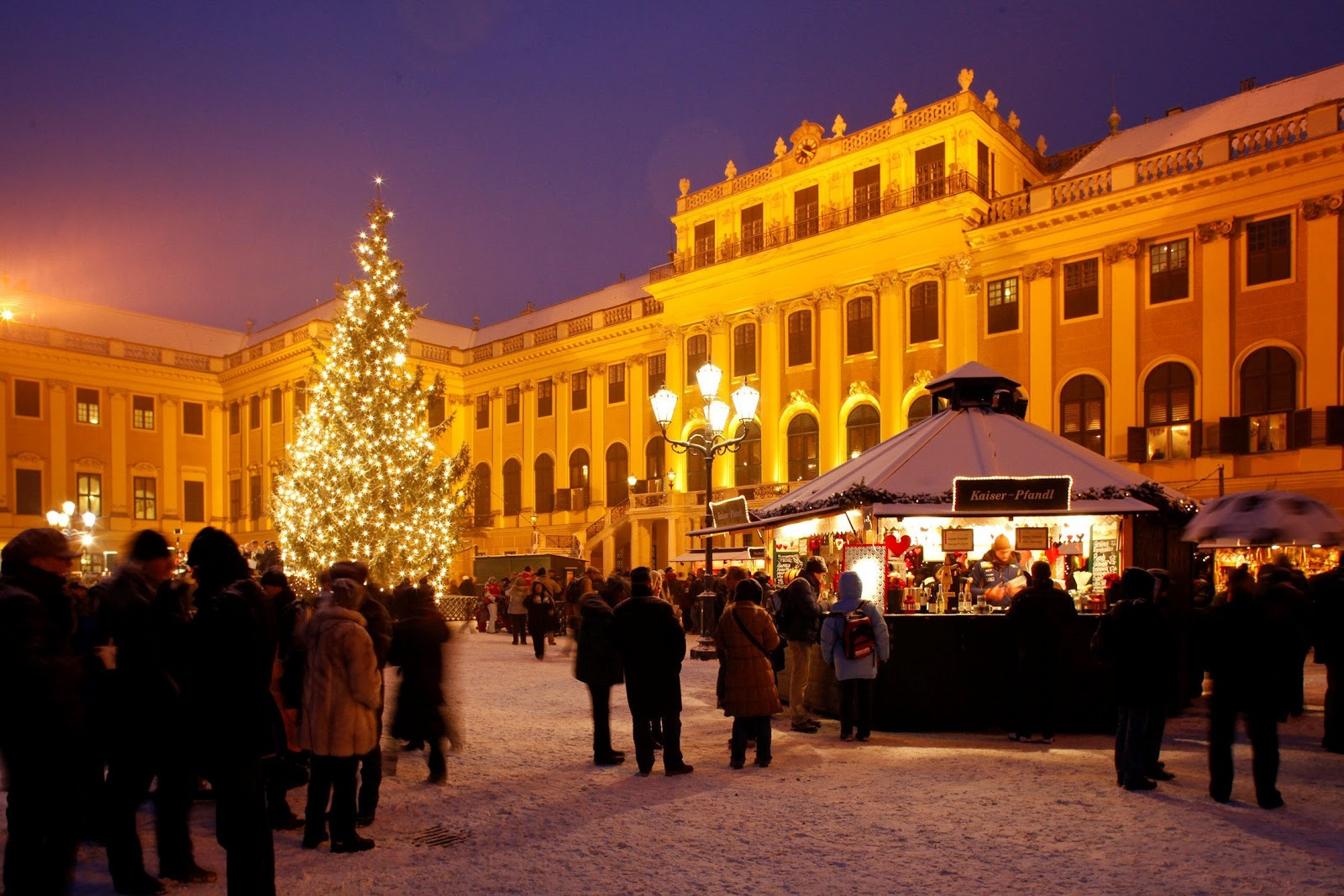 Austria's exquisite Schönbrunn Palace aglow under the Christmas market light. Photo: Courtesy of Austria Tourism. Unauthorized use is prohibited.