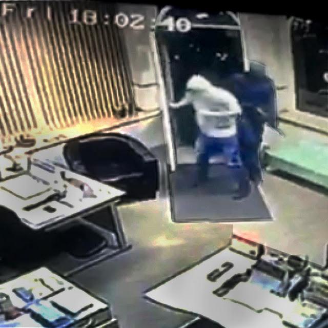 Dramatic footage of armed raid at Bradford travel agents
