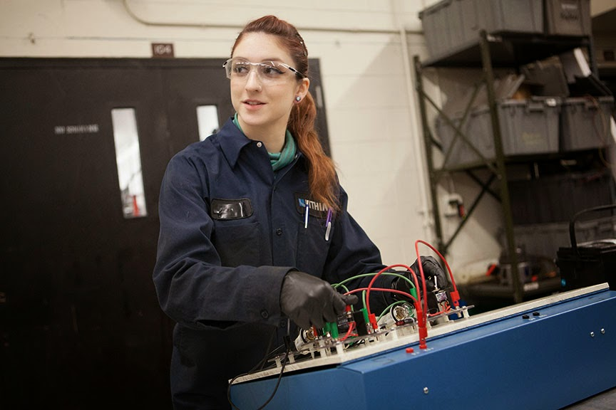 Automotive technology student Kaitlin Woodward works on a circuit project at the Automotive/Diesel Technology building on the University of Alaska Anchorage campus.  (Photo by Philip Hall/University of Alaska Anchorage)