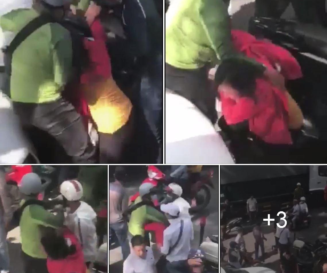 Người biểu tình bị \u0027côn đồ\u0027 (bịt khẩu trang, áo xanh đọt chuối) trấn áp. Ảnh: Le Dung Vova