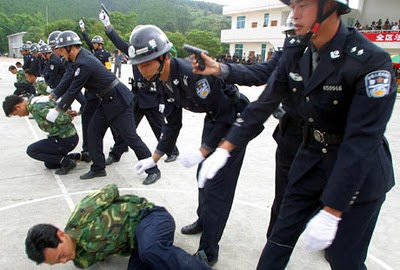 Chinese police officers rehearse execution procedures.