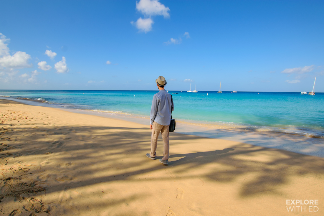 Travel blogger Explore With Ed walking along the beaches of Barbados