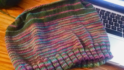 hand knit cowl on the knitting needles