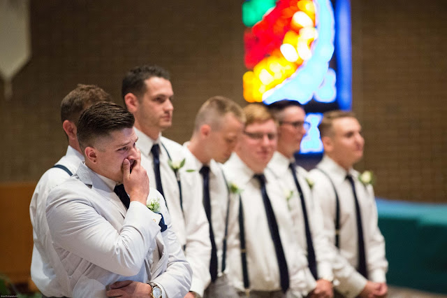groom crying as bride walks down the isle st. malachy catholic church