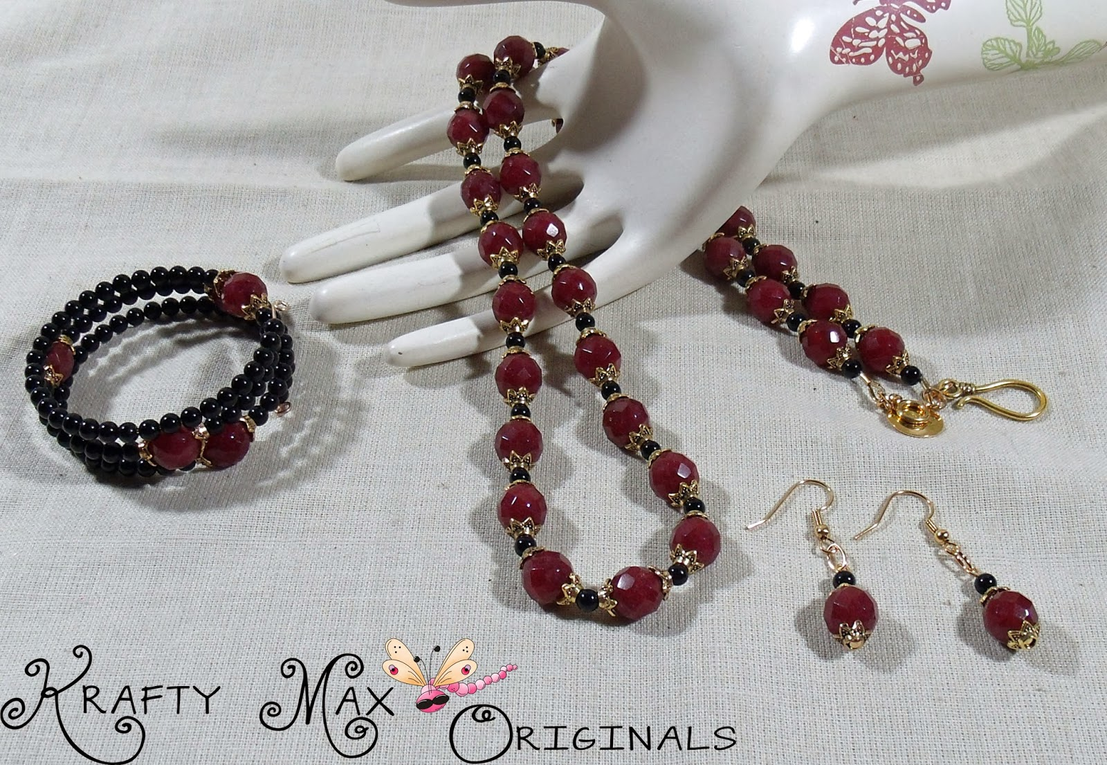 http://www.lajuliet.com/index.php/2013-01-04-15-21-51/ad/gold,93/exclusive-red-black-and-gold-3-piece-necklace-set-a-krafty-max-original-design,152