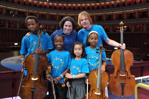 Julian Lloyd Webber and Gustavo Dudamel with In Harmony children
