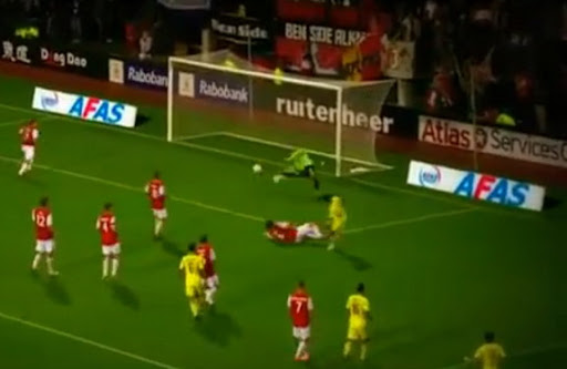 Anzhi Makhachkala striker Samuel Eto'o scores after beating four AZ Alkmaar players