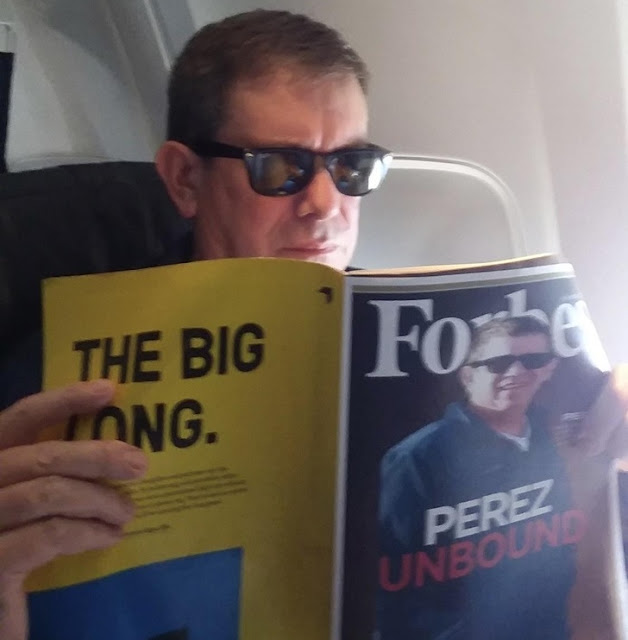 This guy reading about himself in Forbes