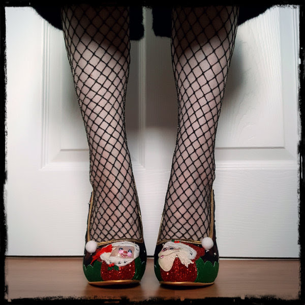 front view of feet wearing metallic fishnet tights and Santa and Mrs Claus shoes