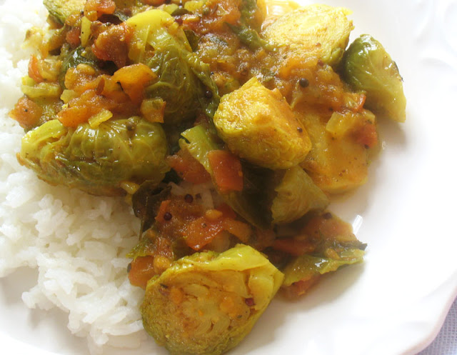 curried brussels in a spicy tomato sauce
