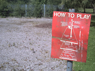 The Petanque terrain at Wythenshawe Park - and a handy How to Play sign!