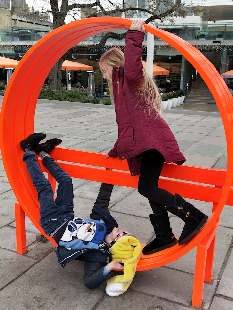 playing on benches in london