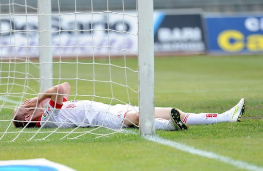 Bari defender Andrea Masiello reacts after scoring an own goal against Lecce
