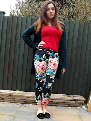 Person posing in floral trousers