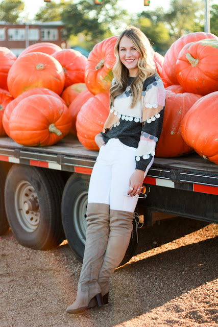 Girl wearing a tassel sweater in pumpkin patch
