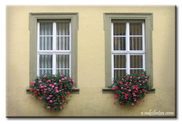 Pink and red flowers in German window boxes