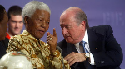 Nelson Mandela with Fifa president Sepp Blatter. You could say a force of good meets a force of evil ...