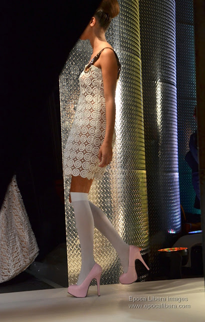 Dresses decorated with lace and embroidery of Panos Apergis collection catwalk, as seen from backstage.