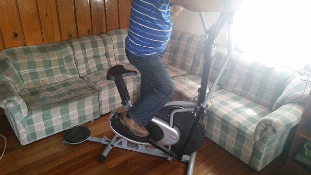 An inspired man in elliptical bike to always stay fit