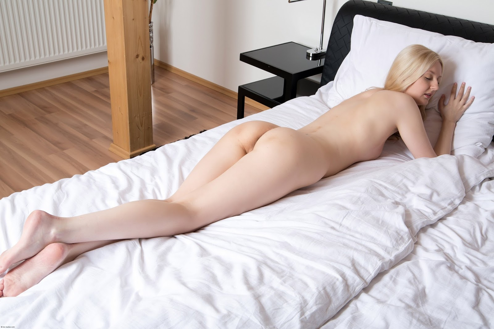 Gentle Teen Girl Demetra A Lays Naked On The Back In The Bedroom