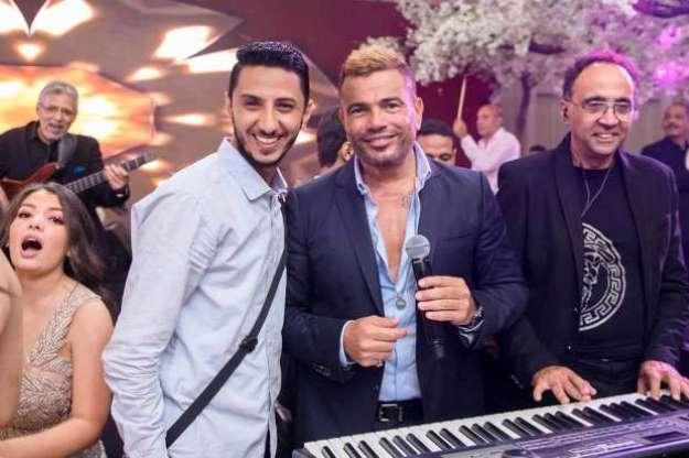 عمرو دياب يكشف لوك ألبومه الجديد