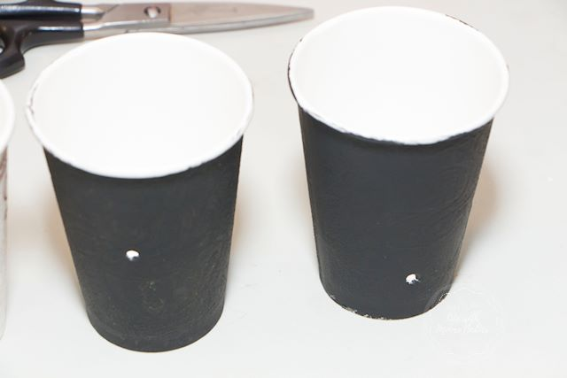 These cups only let in a tiny dot of light for plants to grow towards.
