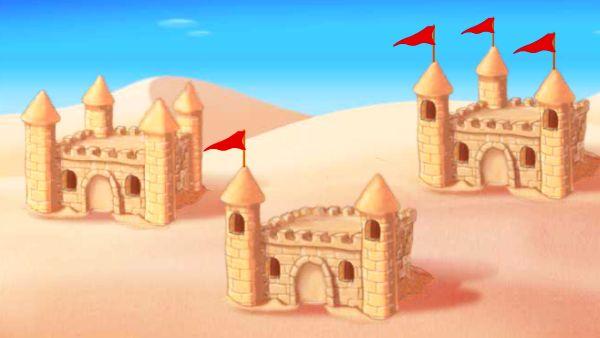 three sandcastles on a beach