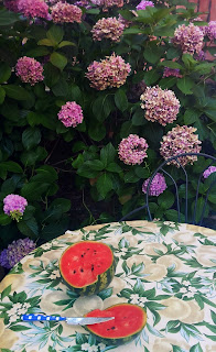Watermellon on the table in the garden