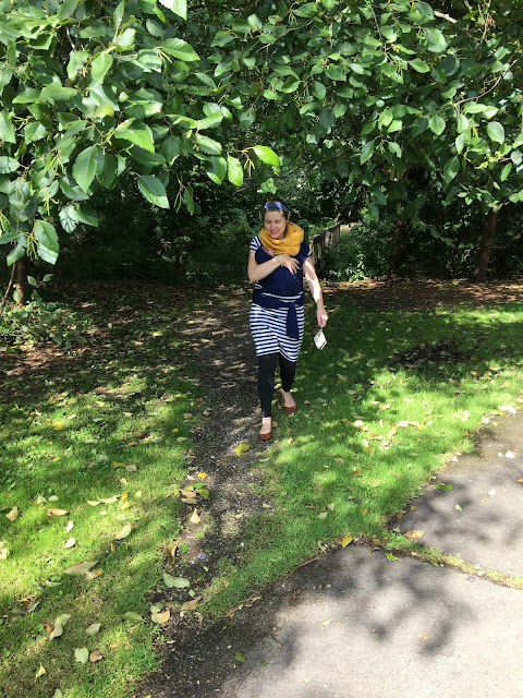 new mom babywearing out on a walk fourth trimester