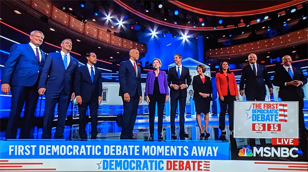screenshot of the ten candidates in the first night of the first debate standing onstage just before the debate began
