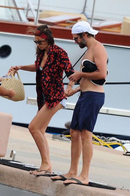 Irina Shayk in Bikini Top at a dock in Sardinia