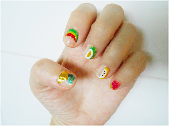 Korean inspired negative space fruit nail art design