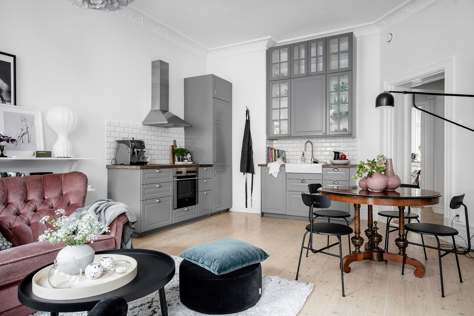 gray kitchen cabinets, vintage dining table, pink decor, small scandinavian apartment interior