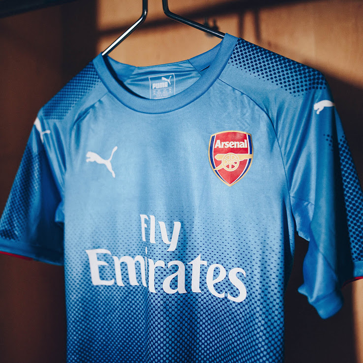 The Arsenal 17-18 away shirt s official colors are Blue Danube (light blue)  and Limoges (dark blue). +3 fbb11f454