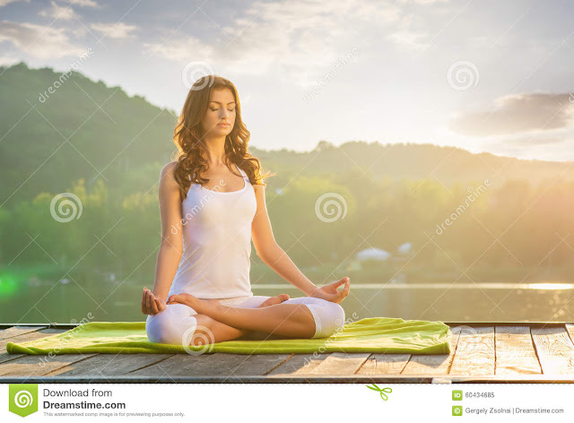 Girl meditating in Padmasana