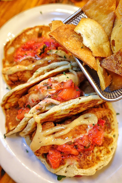 Chicken and Pancake Tacos at Treylor Park in Savannah, GA. Fried chicken tenders, topped with a honey chili and strawberry salsa served in pancake taco shells